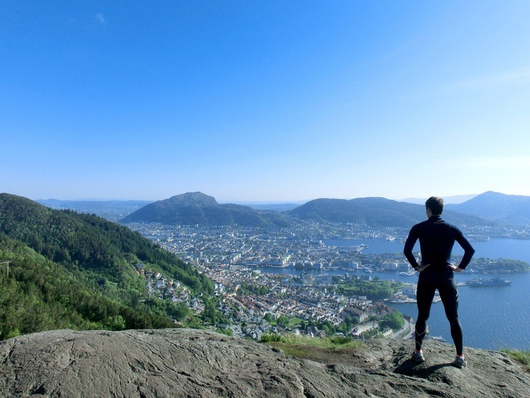 Man at the summit of Stoltzekleiven on a sunny day