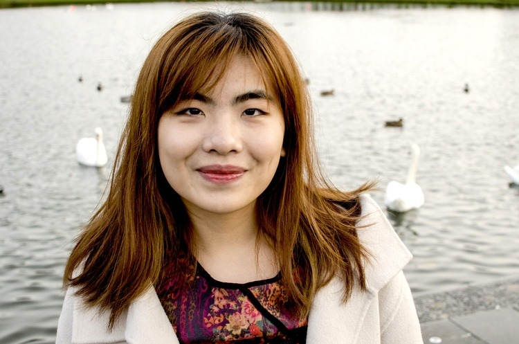 Photo of Belinda in front of lake with swans in background